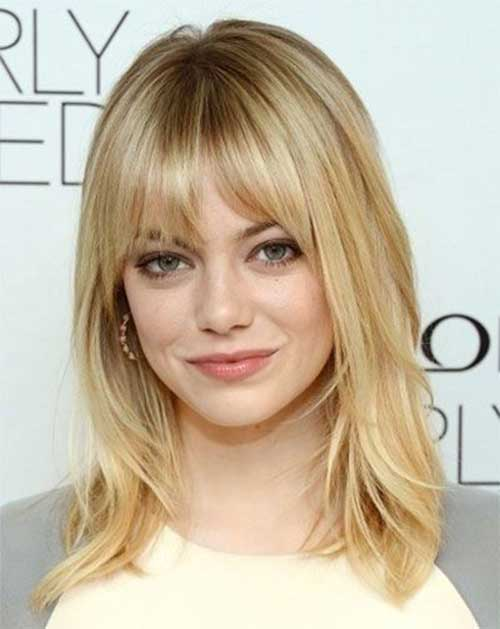 Medium Length Blonde Hairstyle With Bangs